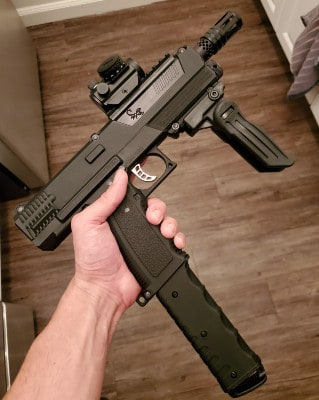 Tippmann TiPX with extended magazine, foregrip, red dot, and barrel tip